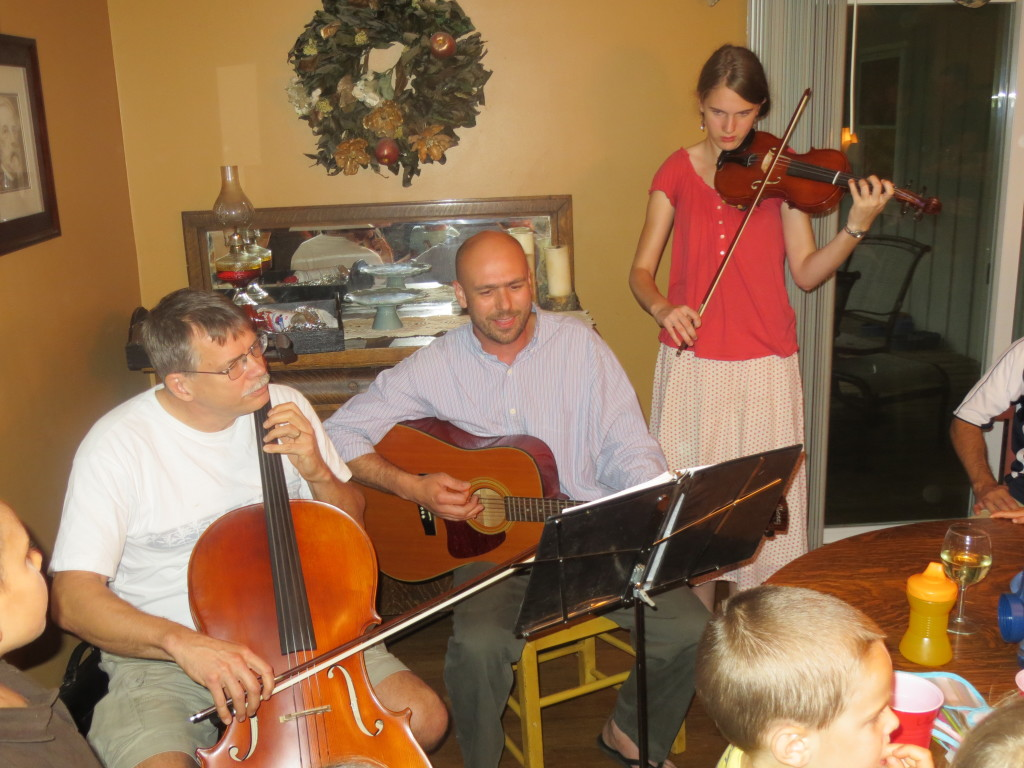 Amber (15) plays the violin along with the guitar and cello as we sing at one of our Sunday afternoon gatherings.