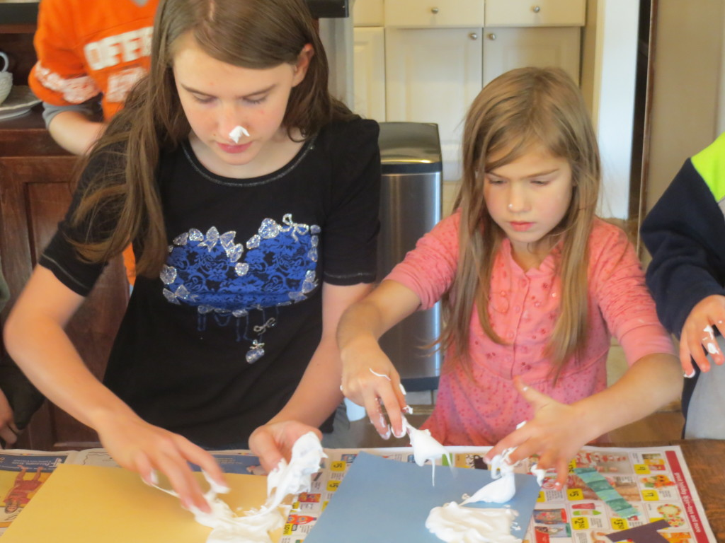 Kaitlin (14) and Savannah (7) working on a project.