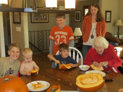 Carter (11), Valor (1), Nick (5), Grandma, Matthew (14) and Amber (17) prepping pumpkin for pies, soup and the freezer