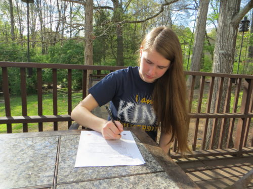 Kaitlin signing NCAA forms to run cross country for King University