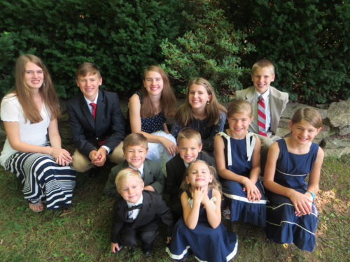 Back row L-R: Amber (19), Matthew (17), Kaitlin (18), Alyssa (16), Carter (14) Middle row: Nick (8), Colby (10), Savannah (11), Sadie (13) Front: Valor (4), Bella (6)