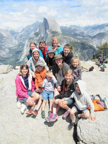 Our whole family at Glacier Point in Yosemite National Park